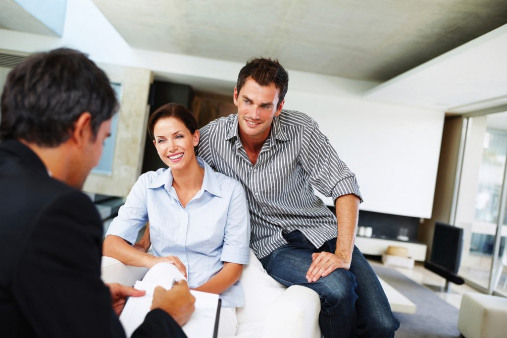 Couple meeting with agent in office
