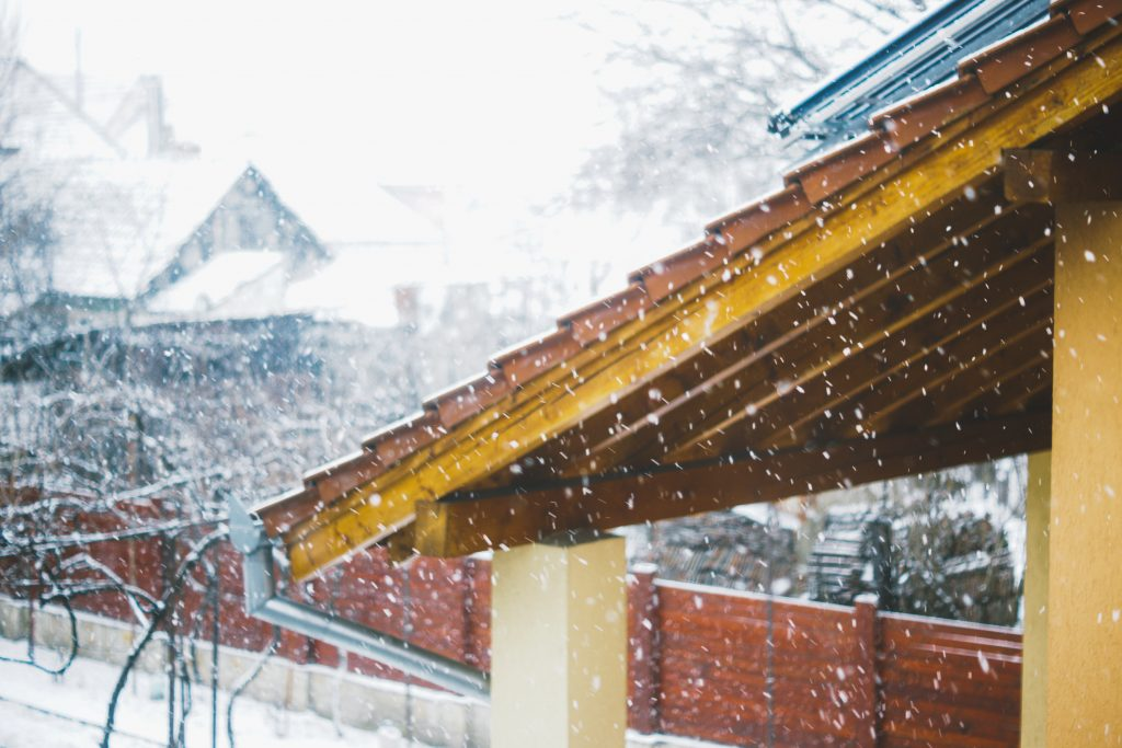 Roof with brick fence covered in snowflakes