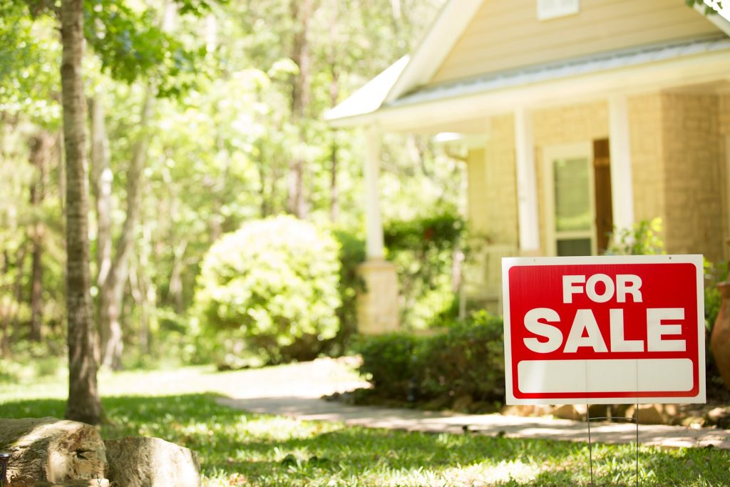 Red For Sale sign outside home